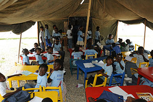 Haitian children attend school classes provide...